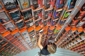 FRANKFURT AM MAIN, GERMANY - OCTOBER 08:  A host arranges books at the'Knaur' publishing house stand a day before the launch of the 2013 Frankfurt Book Fair on October 8, 2013 in Frankfurt, Germany. This year's fair will be open to the public from October 9-13 and the official partner nation is Brazil.  (Photo by Thomas Lohnes/Getty Images)